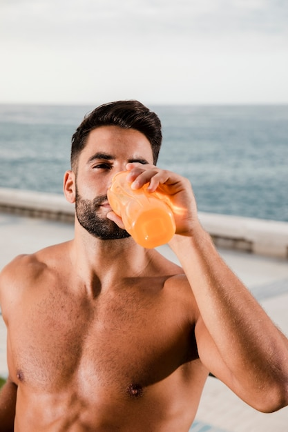 Young man hydrating after outdoor training Free Photo