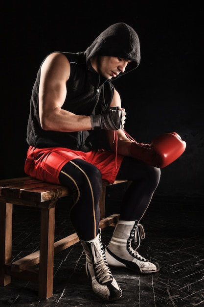 The young  man kickboxing lacing glove Free Photo