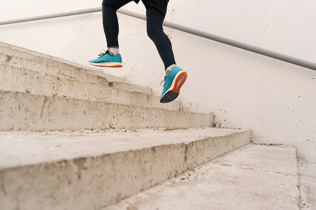 Young man legs doing interval workout on stairs Free Photo