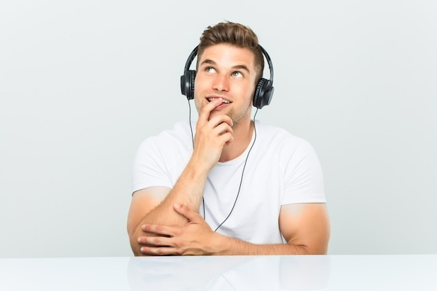 Young Man Listening To Music With Headphones Relaxed