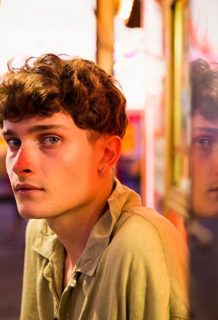 Young man looking at camera at funfair Free Photo