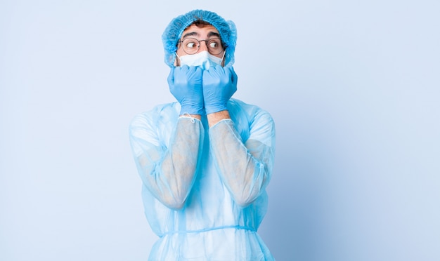 Young man looking worried, anxious, stressed and afraid, biting fingernails and looking to lateral copy space. coronavirus concept Premium Photo