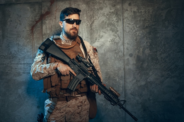 Young man in military outfit a mercenary soldier in modern times Premium Photo
