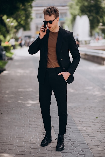 Young man model using phone Free Photo