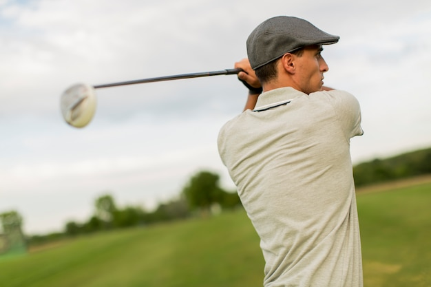 Young man playing golf Premium Photo