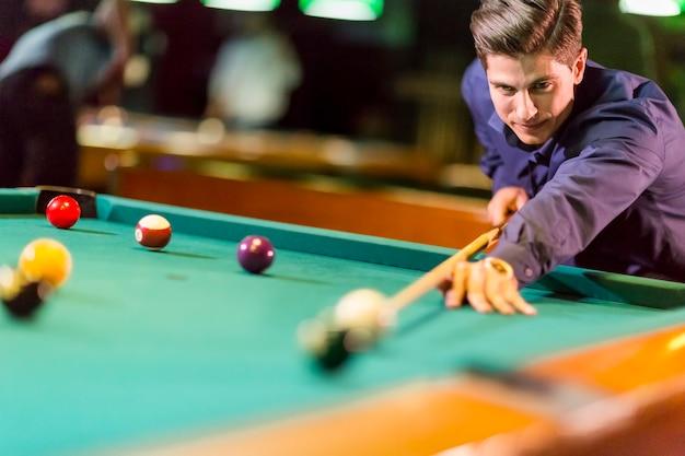 Young man playing pool Premium Photo