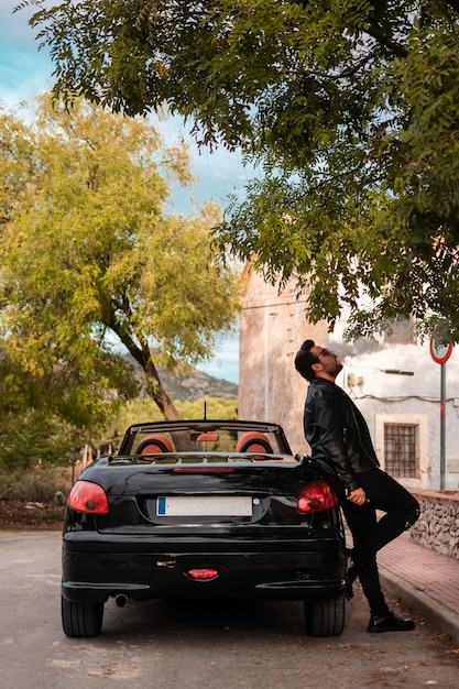 Young man posing in a convertible car. Premium Photo