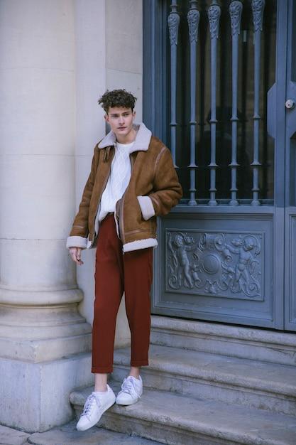 Young man posing at front door Free Photo