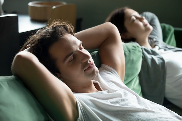 Young man relaxing on comfortable couch with girlfriend at home Free Photo