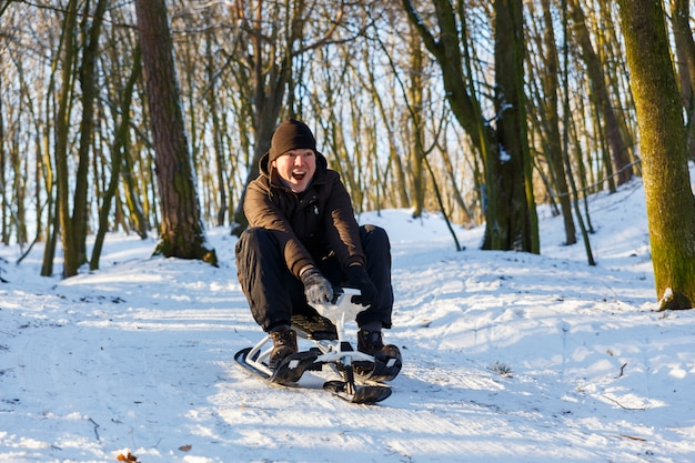 Young man riding a snow scooter Premium Photo