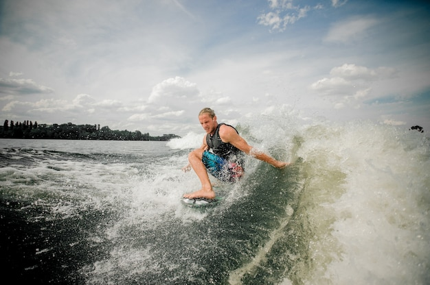 Young man runing on the wakeboard down the river Premium Photo