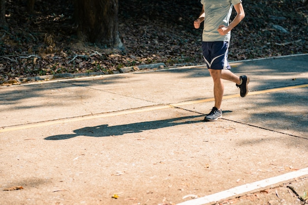 Young man runner athlete running at road in a park Premium Photo