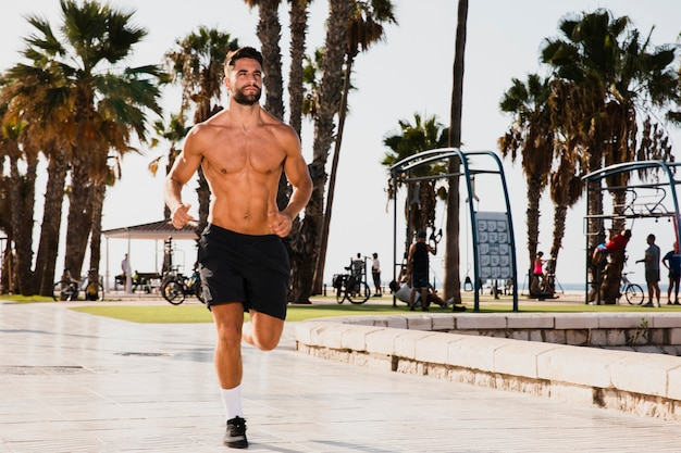 Young man running practice outside Free Photo