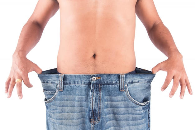 Young man show body after weight loss Premium Photo