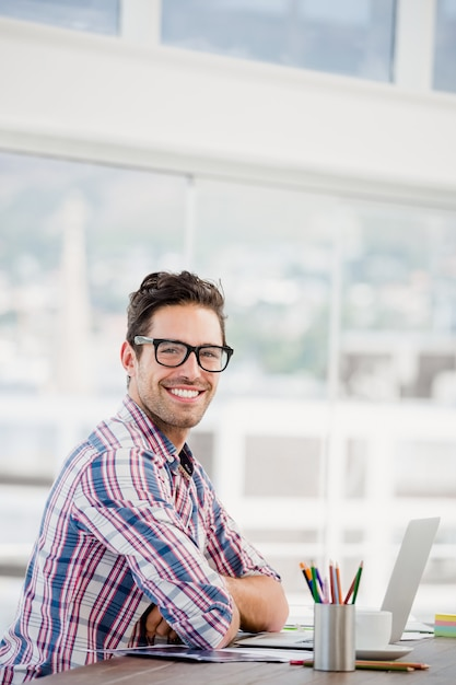 Young man sitting at his desk Premium Photo