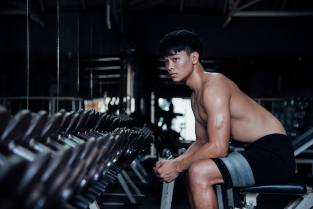 Young man in sportswear an exercise class in a gym Free Photo