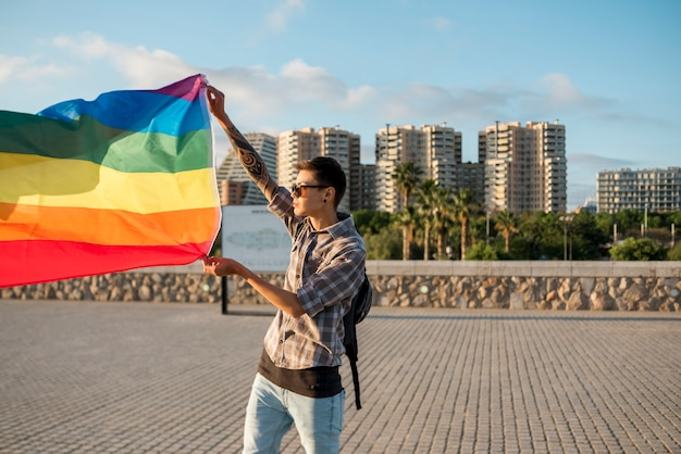 Young man standing with lgbt flag Free Photo