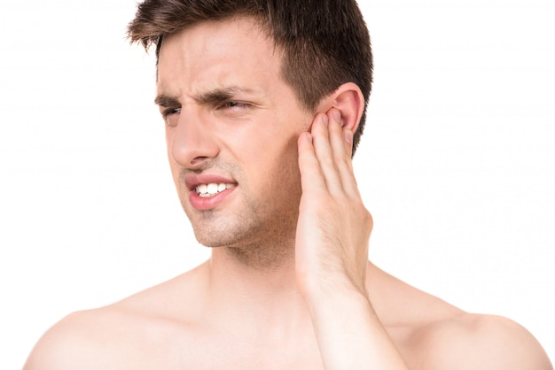Young man suffering from pain closing ear with hand. Premium Photo