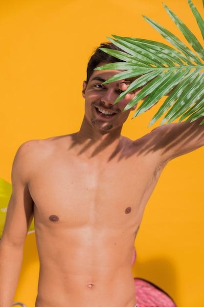 Young man sunbathing on beach Free Photo