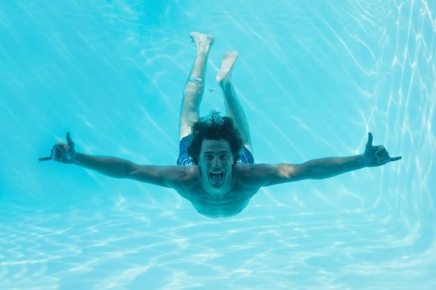 Man treading water in swimming pool - Stock Image - F005