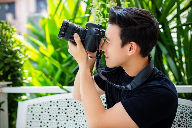 Young man taking photograph with happy Free Photo