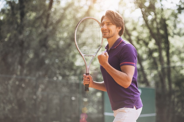 Young man tennis player at the court Free Photo