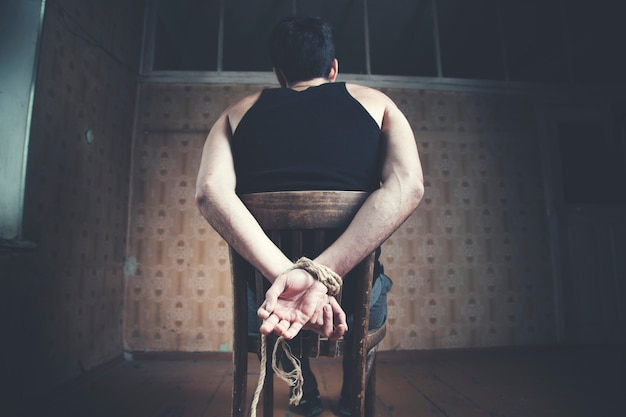 Young man tied to chair Premium Photo