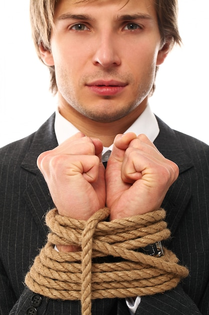 A young man tied with rope Free Photo