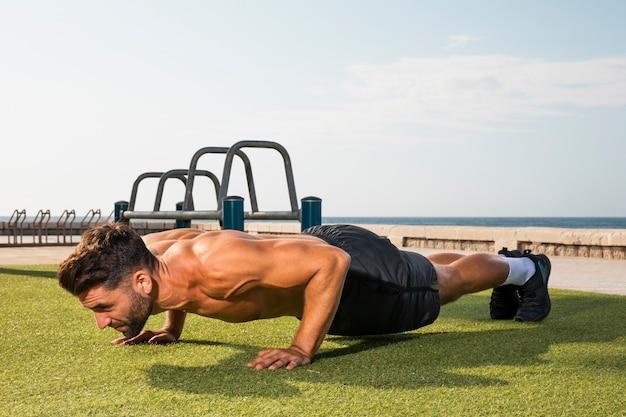 Young man training exercise pushups Free Photo