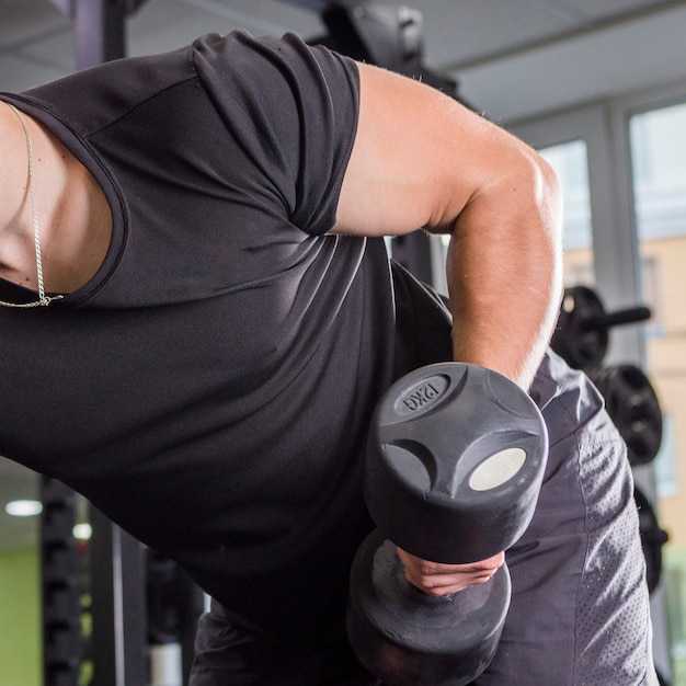 Young man training in the gym Free Photo