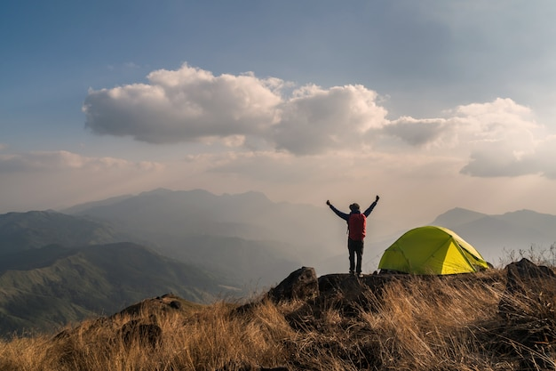 Young man traveler with backpack camping on mountain Premium Photo