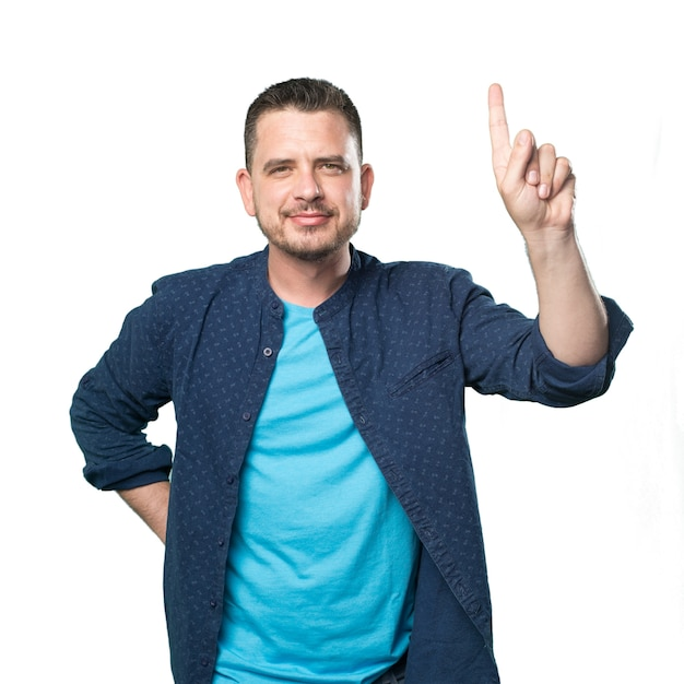 Young man wearing a blue outfit. doing one number gesture. Free Photo