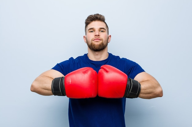 Young man wearing a boxing gloves Premium Photo
