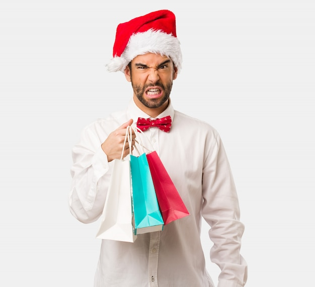 Young man wearing a santa claus hat on christmas day Premium Photo