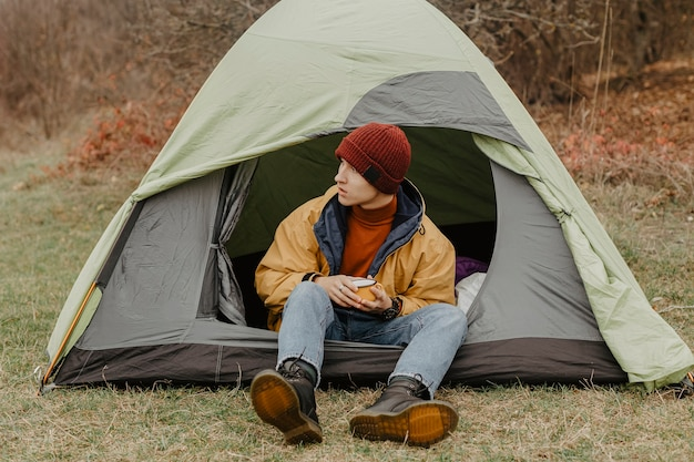 Young man on winter trip with tent Free Photo
