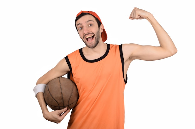 Young man with basketball ball. Premium Photo