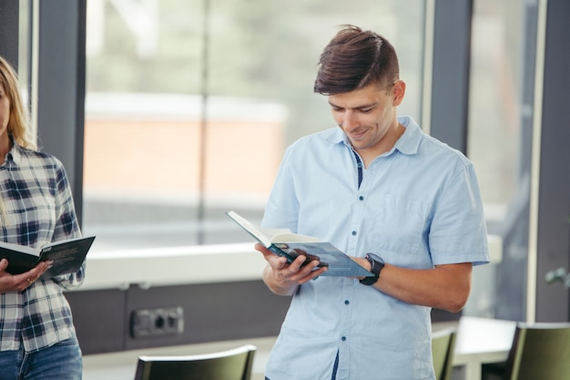 Young man with book Free Photo