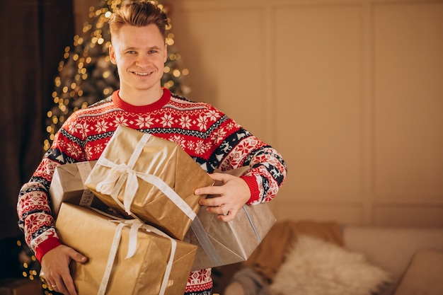 Young man with christmas presents Free Photo