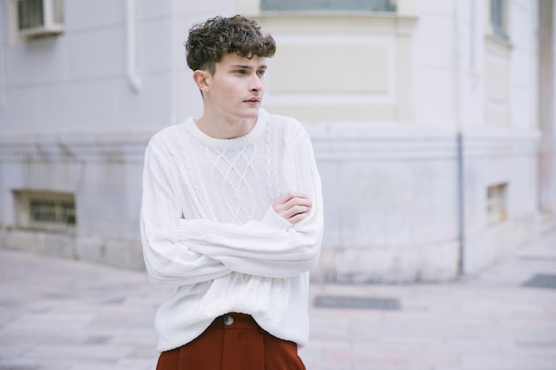 Young man with crossed arms Free Photo