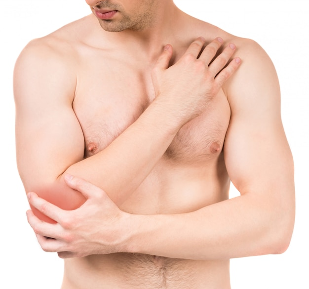 Young man with elbow pain Premium Photo