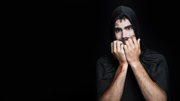 Young man with frightened face in halloween costume posing in studio Free Photo