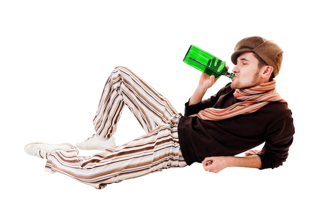 Young man with green bottle Free Photo