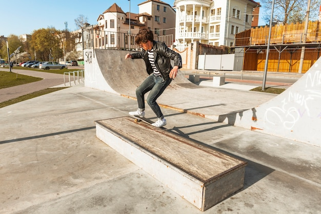 Young man with his skateboarding at the skate park Free Photo