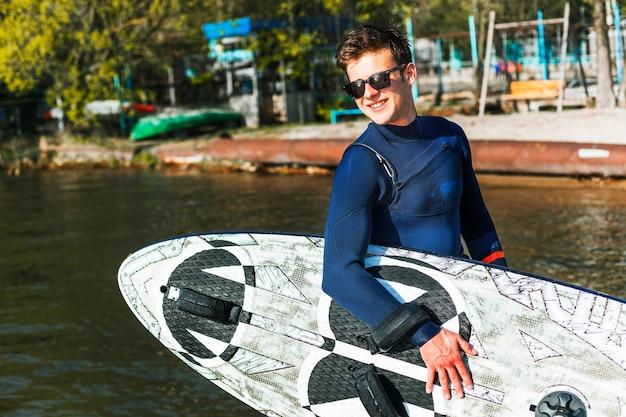 Young man with kitesurf board Free Photo