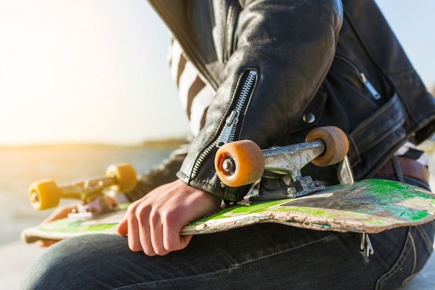 Young man with a skateboard near the sea Free Photo