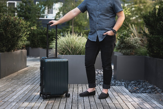 Young man with a suitcase Free Photo