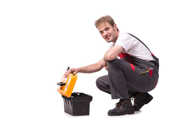 Young man with toolkit toolbox isolated on white Premium Photo