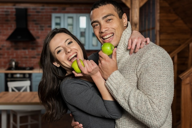 Young man and woman having an apple Free Photo