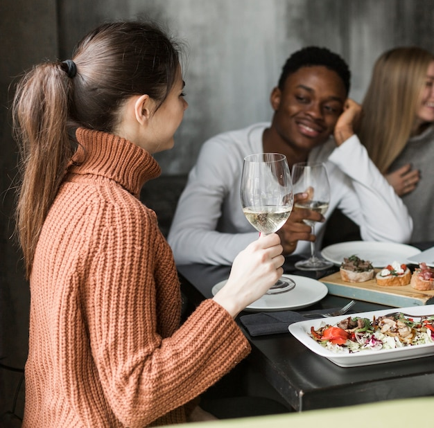 Young man and woman having dinner together Free Photo
