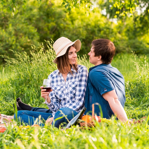 Young man and woman on picnic date Free Photo
